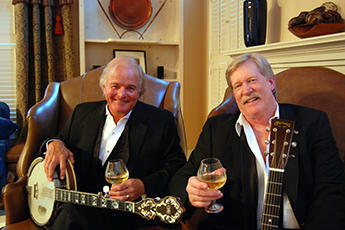 Banks & Shane in Tuxes with banjo and wine glass