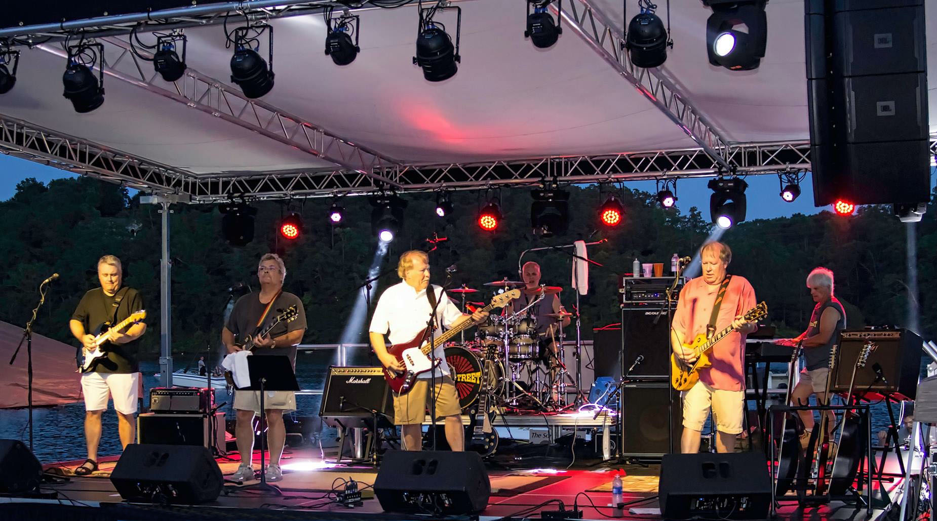 The band Riverstreet performing on stage.